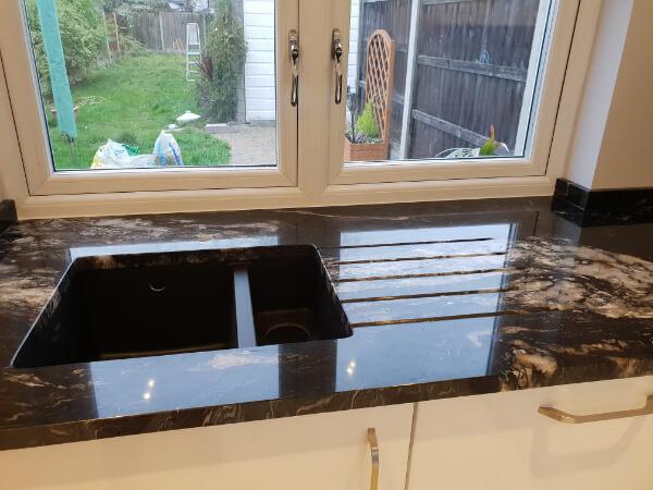 black granite sink welling